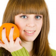 Girl with orange — Stock Photo #2250937