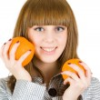 Girl with orange — Stock Photo #2250945