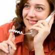 Happy young woman talking on phone - Stock Photo