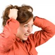 Young woman pulling her hair — Stock Photo