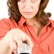 Woman using tv remote control — Stock Photo