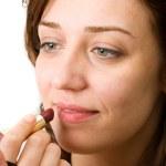 Young woman doing makeup — Stock Photo #2252543