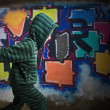 Kid in front of graffiti wall — 图库照片