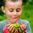 Boy eating papaya — Stock Photo