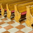 Benches in church - Stock Photo