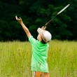 Постер, плакат: Boy playing badminton