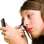 Young woman doing makeup — Stock Photo