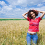 Woman in a wheat field — Stock Photo #2254890
