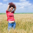 Woman in a wheat field — Stock Photo