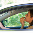 Woman doing make-up in car — Stock Photo