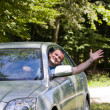Man waving hand from car — Stock Photo