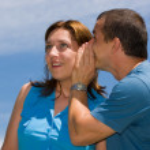 Couple sharing secrets — Stock Photo