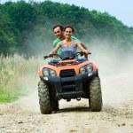 Couple riding ATV — Stock Photo