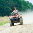 Stock Photo: Woman riding ATV