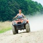 Woman riding ATV — Stock Photo
