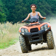 Woman riding ATV - Stock Photo