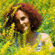 Woman in flower field — Stock Photo