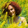 Woman in flower field — Stock Photo #2255642
