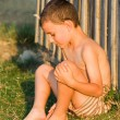Boy sitting near wall — Stock Photo #2255881
