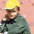 Cute boy with yellow cap — Stock Photo #2256047