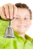 Boy ringing a bell — Stock Photo