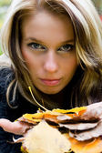 Blonde woman with golden leaves — Stock Photo