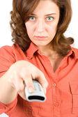 Woman using tv remote control — Stock Photo