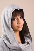 Brunette with sweater and hood — Stock Photo