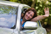 Happy woman in car — Stok fotoğraf