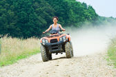Woman riding ATV — Stock Photo