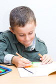 Cute kid drawing — Stock Photo