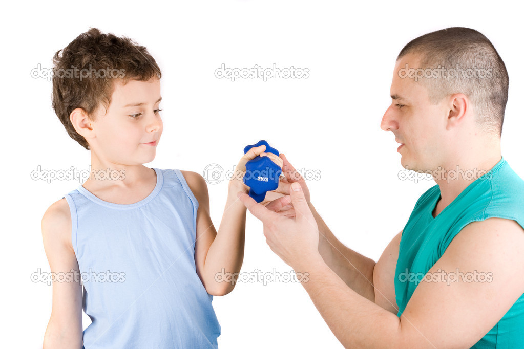 8 years old boy doing fitness with his father as a coach — Stock Photo #2250635