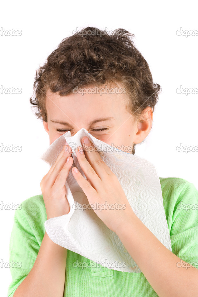 Close-up portrait of a child wiping his nose  Stock Photo #2250742