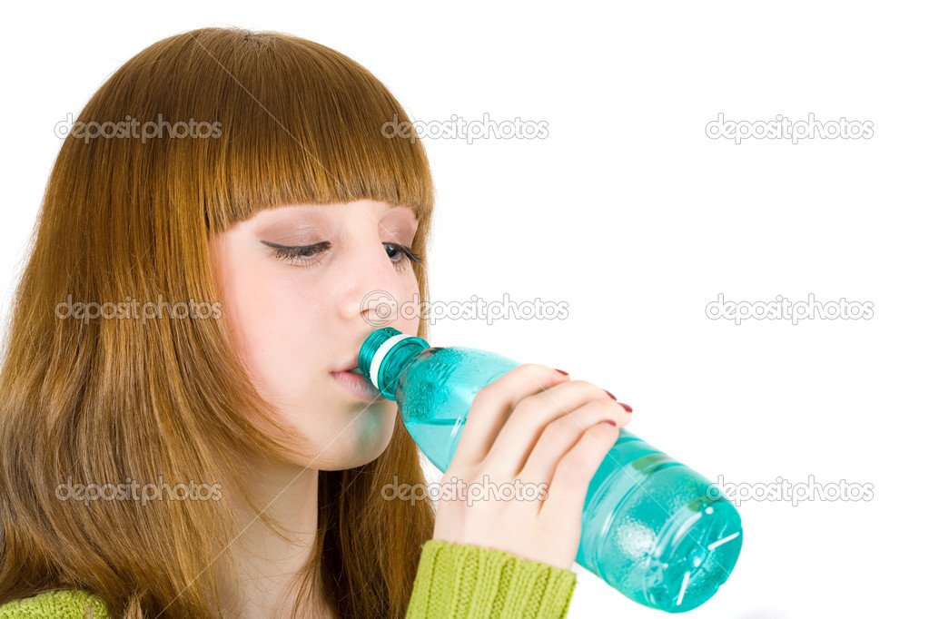 Portrait of an attractive blonde drinking water, isolated on white background — Stock Photo #2250989