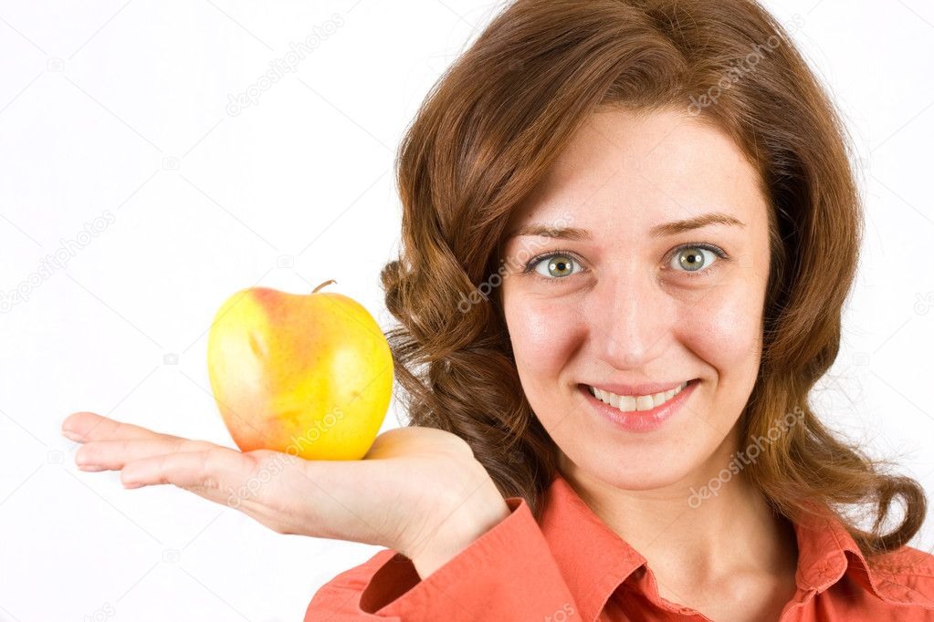 Portrait of a young woman holding a fresh yellow apple, isolated on white — Stock Photo #2252014