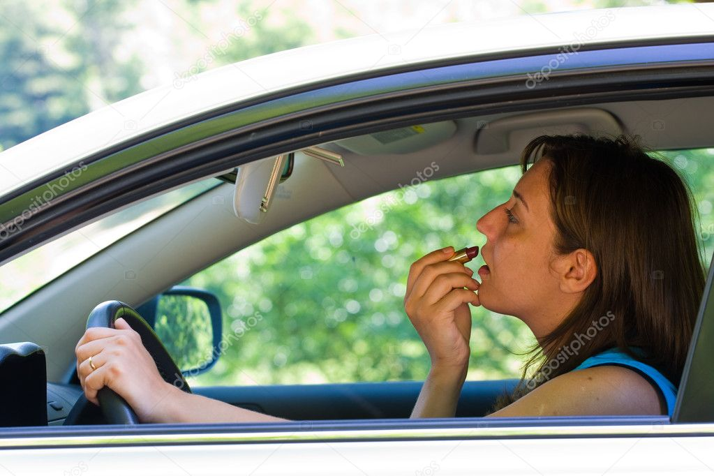 Woman doing make-up while driving — Stock Photo #2254916