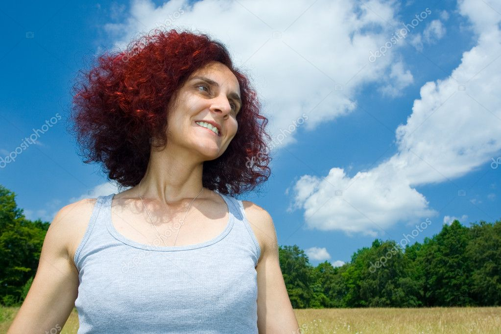 Portrait of a beautiful redhead woman near a forest — Stock Photo #2255618