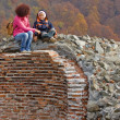 Mother and son climb on castle ruins — Stockfoto