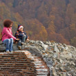 Mother and son climb on castle ruins — Foto de Stock