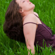 Beautiful lady in a grassfield — Stock Photo
