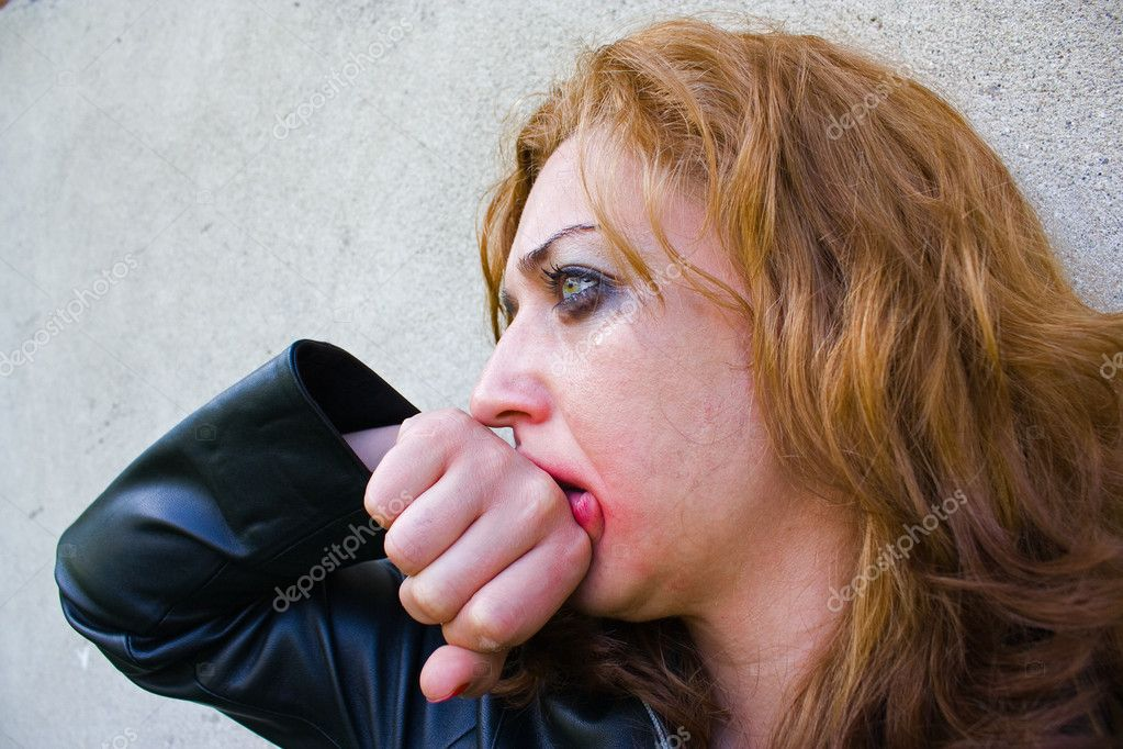 Portrait of an abused blond woman near a wall — Stock Photo #2274882
