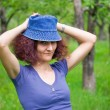 Woman with cap in an orchard — Stock Photo #2280081