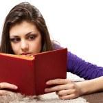 Latin girl reading book — Stock Photo
