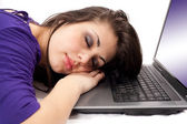 Young woman sleeping on laptop — Stok fotoğraf
