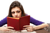 Latin girl reading book — Stock Photo