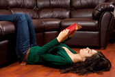 Young lady reading a vintage book — Foto de Stock
