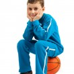 Boy sitting on basketball — Stock Photo #2416640