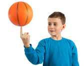 Kid spinning basketball with motion blur — Stock Photo