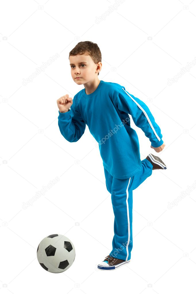 Adorable football kid executing a kick, isolated on white background — Stock Photo #2416729