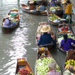 AMPAWA.Food vendor works on boats at the floating market — Stock Photo